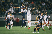 Monterrey defender Jose Maria Basanta, left, heads the ball over Los Angeles Galaxy forward Robbie Keane during the second half of the CONCACAF Champions League semifinal, Wednesday, April 3, 2013, in Carson, Calif. Monterrey won 2-1. (AP Photo/Bret Hartman)