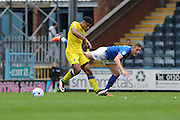 AFC Wimbledon striker Lyle Taylor (33) and Rochdale FC defender Jim McNulty (4) tangle during the EFL Sky Bet League 1 match between Rochdale and AFC Wimbledon at Spotland, Rochdale, England on 27 August 2016. Photo by Stuart Butcher.