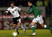 Fotball<br /> VM-kvalifisering<br /> Nord Irland v Østerrike<br /> Belfast<br /> 13. oktober 2004<br /> Foto: Digitalsport<br /> NORWAY ONLY<br /> Roland Kirchler (AUT), Keith Gillespie (NIR)