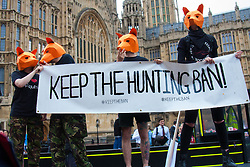 "Westminster, London, July 14th 2015. Hundreds of animal rights activists and members of hunt saboteur groups gather outside Parliament to ""Fight For THe Fox"" as Paliament discusses an amendment to the bill outlawing fox hunting that could see the sport return to the British countryside."