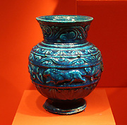 Three decorated jars, 1st c AD.  Stately bicolour faience vessels with fine leafy ornament have been found fairly frequently in Alexandria, the Fayum towns and Middle Egypt.