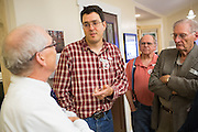 Marty Riker, center, talks with Mike McInerney, left, during the No On Measure E party at a private residence during the midterm election in Milpitas, California, on November 4, 2014. (Stan Olszewski/SOSKIphoto)
