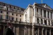 A businessman stands in mid-afternoon sunshine during a break beneath the Bank of England in Bank triangle in the City of London. The Bank of England (formally the Governor and Company of the Bank of England) is the central bank of the United Kingdom and the model on which most modern central banks have been based. Established in 1694 acted as the English Government's banker, and to this day it still acts as the banker for HM Government. The Bank was privately owned and operated from its foundation in 1694. It was subordinated to the Treasury after 1931 in making policy and was nationalised in 1946. In 1997 it became an independent public organisation, wholly owned by the Treasury Solicitor on behalf of the Government, with independence in setting monetary policy.