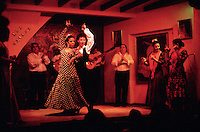 "September 1991, Sevilla, Spain --- Flamenco dancers perform at the club ""El Gallo"" in Seville, Spain. 
