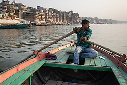 May 18, 2019 - Varanasi, India - On 18 May 2018, a young Indian man rows a row boat on the Ganges River, which is considered to be holy and pure in the Hindu religion. Photo taken in the city of Varanasi, India. (Credit Image: © Diego Cupolo/NurPhoto via ZUMA Press)