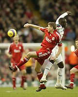 Photo: Aidan Ellis.<br /> Liverpool v Bolton Wanderers. The Barclays Premiership. 01/01/2007.<br /> Liverpool's Steven Gerrard tangles with Bolton's Abdoulaye Faye