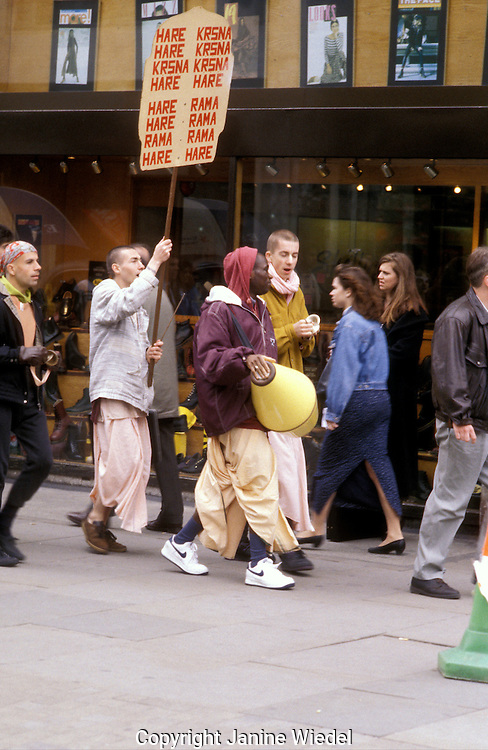 Hare Krishna in London dancing and playing music recruiting people.