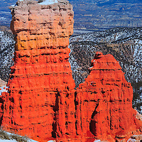 Red Rock formations illuminated by light reflected off the snow near Natural Bridge in Bryce Canyon Utah.