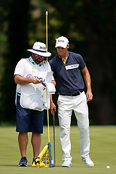 August 12, 2018 - St. Louis, Missouri, United States - Martin Kaymer (R) and his caddie Craig Connelly line up a putt on the 9th green during the final round of the 100th PGA Championship at Bellerive Country Club. (Credit Image: © Debby Wong via ZUMA Wire)