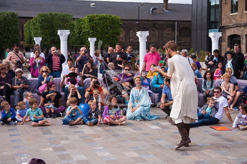 Granary Square, Kings Cross, London, August 30th 2014.  A performer dressed in Roman attire entertains crowds at Granary Square in King's Cross at the Battle Bridge: Boudicca Vs The Romans event, which brings alive the ancient history associated with the area, from when London was part of the Roman empire. PAYMENT/CONTACT DETAILS: paul@pauldaveycreative.co.uk Tel +44 (0) 7966 016 296 or +44 (0) 208 969 6875