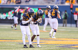Nov 14, 2020; Morgantown, West Virginia, USA; West Virginia Mountaineers safety Tykee Smith (23) celebrates with West Virginia Mountaineers cornerback Alonzo Addae (4) after intercepting a pass during the fourth quarter against the TCU Horned Frogs at Mountaineer Field at Milan Puskar Stadium. Mandatory Credit: Ben Queen-USA TODAY Sports