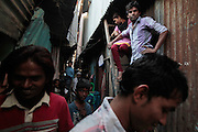 The narrow alleyways between the homes create for close quarters but keep social activity high.  The slum of Cheetah Camp on the outskirts of Mumbai, India is a predominantly muslim community on living on the fringe while the city continues to grow.