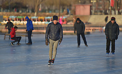 January 2, 2018 - Qiqihar, Qiqihar, China - Qiqihar, CHINA-2nd January 2018:(EDITORIAL USE ONLY. CHINA OUT) ..People enjoy skiing on the frozen lake at a park in Shenyang, northeast China's Liaoning Province, January 2nd, 2017. (Credit Image: © SIPA Asia via ZUMA Wire)