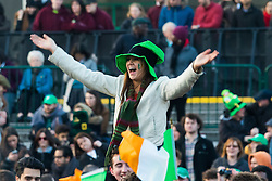 London, March 13th 2016. The annual St Patrick's Day Festival takes place in Trafalgar Square with performances on stage and plenty of Irish food and drink for the thousands of revellers.  PICTURED: A woman on someone's shoulders dances above the crowd. ©Paul Davey<br /> FOR LICENCING CONTACT: Paul Davey +44 (0) 7966 016 296 paul@pauldaveycreative.co.uk