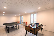Games room with table tennis and table football. Nobody inside.