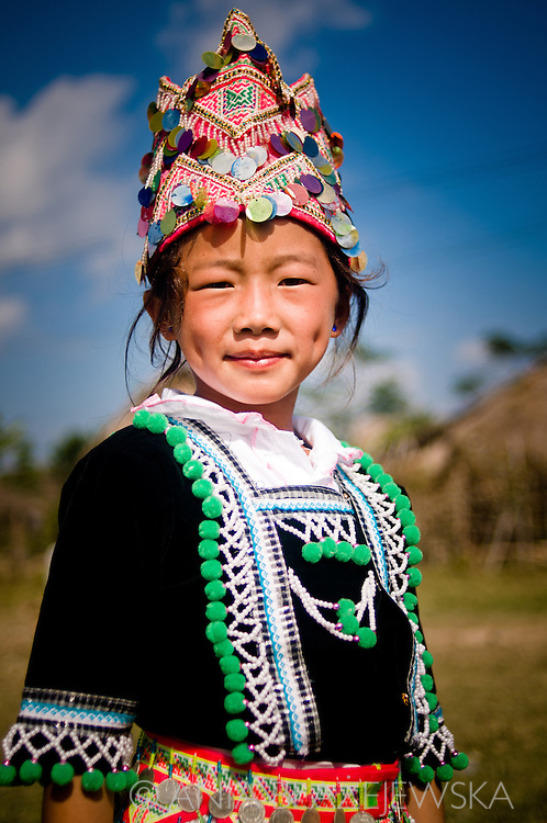 Laos, Muang Sing. Hmong girl wearing a beautiful dress and hat because of the Hmong New Year's festival.