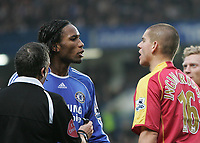Photo: Lee Earle.<br /> Chelsea v Reading. The Barclays Premiership. 26/12/2006. Chelsea's Didier Drogba (L) has words with Ivar Ingimarsson.