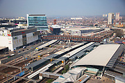 Scene aof Westfield shopping centre and Stratford station near to the 2012 London Olympic Park in East London. Residents in this area are concerned for many reasons including living in the shadow of the mostly disliked steel tower and the possible threat that the entire estate site may be sold off to UCL (University College London). People in this area generally feel very negative towards the Olympics, which they feel is not going to benefit them at all. Meanwhile the new shopping complex which is next to their estate, there are high end shops selling goods they simply cannot afford.