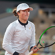 PARIS, FRANCE October 06. Iga Swiatek of Poland in action against Martina Trevisan of Italy in the Quarter Finals of the singles competition on Court Philippe-Chatrier during the French Open Tennis Tournament at Roland Garros on October 6th 2020 in Paris, France. (Photo by Tim Clayton/Corbis via Getty Images)