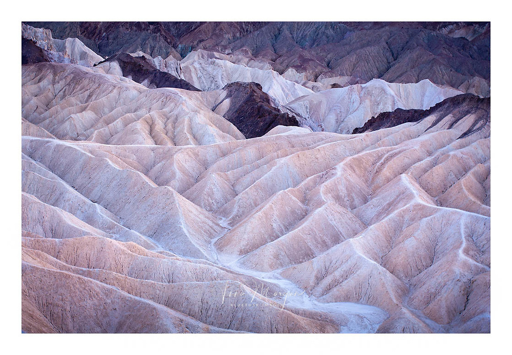 pastel hues of the badlands seen form Zabriskie Point, Death Valley National Park, California.