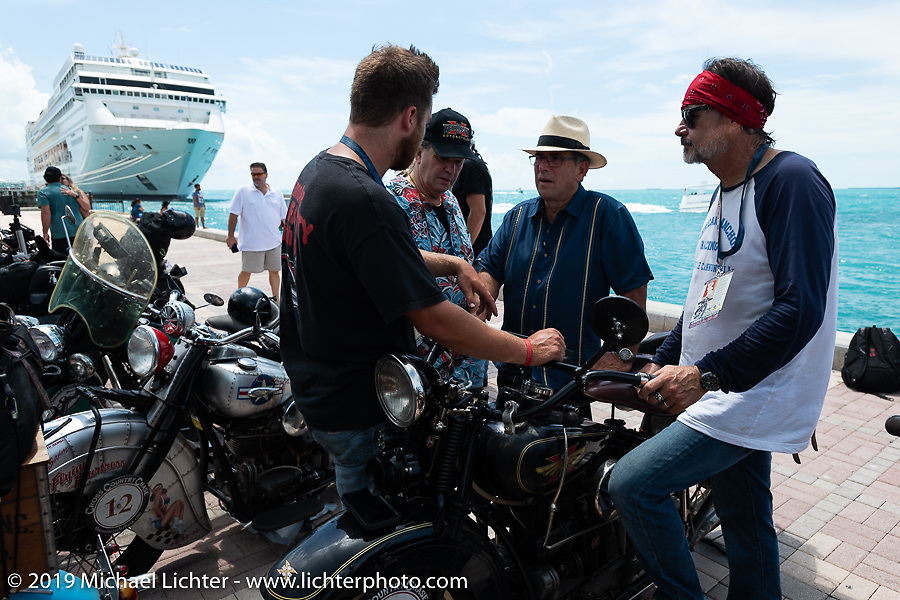 Bob Zeolla and Loring Hill chat with tourists a the end of the Cross Country Chase motorcycle endurance run from Sault Sainte Marie, MI to Key West, FL. (for vintage bikes from 1930-1948). The Grand Finish in Key West's Mallory Square after the 110 mile Stage-10 ride from Miami to Key West, FL and after covering 2,368 miles of the Cross Country Chase. Sunday, September 15, 2019. Photography ©2019 Michael Lichter.