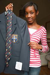 Teenager with her new school uniform