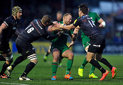 Shane Geraghty of London Irish is tackled by Brett Sharman and Chris Wyles of Saracens - Photo mandatory by-line: Patrick Khachfe/JMP - Mobile: 07966 386802 03/01/2015 - SPORT - RUGBY UNION - London - Allianz Park - Saracens v London Irish - Aviva Premiership