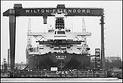 Nederland, Rotterdam, 15-5-1988De NV Dok en Werf Maatschappij Wilton-Fijenoord, WF, was tussen 1929 en 1999 een scheepswerf in Schiedam, gespecialiseerd in scheepsreparatie en scheepsbouw. Van 1971 tot 1983 was het onderdeel van het RSV-concern. De scheepsnieuwbouw werd in 1988 gesloten. De reparatieafdeling van het bedrijf is als Damen Shiprepair Rotterdam, onderdeel van Damen Shipyards Group.Foto: Flip Franssen/Hollandse Hoogte