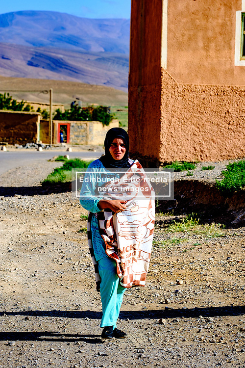 A young woman in traditional dress walking in the village of Tamtetoucht at the foot of the High Atlas in Morocco<br /> <br /> (c) Andrew Wilson   Edinburgh Elite media