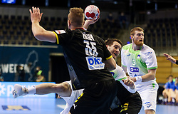 Miha Zarabec of Slovenia vs Julius Kuehn of Germany during handball match between National Teams of Germany and Slovenia at Day 2 of IHF Men's Tokyo Olympic  Qualification tournament, on March 13, 2021 in Max-Schmeling-Halle, Berlin, Germany. Photo by Vid Ponikvar / Sportida