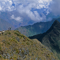 Members of a National Geographic archaeology expedition overlook Cerro Victoris (in shadow), an obscure promontory deep in Peru's rugged Cordillera Vilcabamba, where soon they would find evidence of a long-past Inca commercial center and ceremonial site.