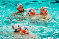 Bilal Gbadamassi, Jorn Muller, Jesse Koopman of the Netherlands in action against Romania during the Olympic qualifying tournament. The Dutch water polo players are on the hunt for a starting ticket for the Olympic Games on February 16, 2021 in Rotterdam