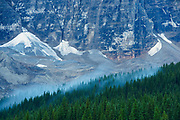 Fog lifting off Mt. Tuzo at Moraine Lake in the Valley of the Ten Peaks.<br />Banff National Park<br />Alberta<br />Canada