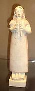 Limestone archaic Greek statue of a man playing two pipes. Cyprus circa 6th century BC