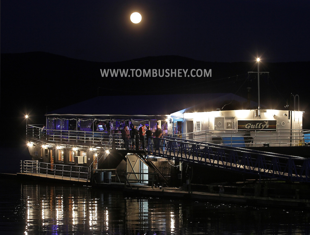 Newburgh, New York - The moon rises behind Gully's bar and restaurant on the Hudson River on the evening of June 15, 2011.