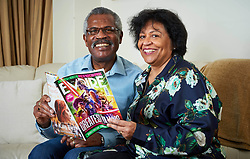 "EXCLUSIVE: SILVER SCREEN - MEET THE HUSBAND AND WIFE COUPLE WHO RETIRED AND DECIDED TO BECOME MOVIE STARS WITH PIX By Magnus News Agency Meet the husband and wife who decided when they retired to try something new in life - so they became MOVIE STARS. Gilbert Newton, 73, and wife Joy, 63, have been married since 1978 but never once imagined they'd be rubbing shoulders with Hollywood greats in their golden years. The couple have worked on nearly 100 films, TV shows, commercials and promotions since signing up to become extras. Far from slowing down, now one or the other of the pair is usually working on something seven days a week and they can be up at 4am to travel to location for filming. Gilbert, a former sales executive, and Joy, a former teacher, from London, say they both love their new jobs so much they don't have any time for the usual hobbies of retirement. Gilbert has appeared on screen in films such as Genius, Florence Foster Jenkins and Kingsman: The Golden Circle and Joy has graced screens on the biggest show on earth appearing in American football Super Bowl advert in 2017. Gilbert said: ""The first film I went for was Genius with Colin Firth and Jude Law. The agent gave me the details and booked me there and I arrived. ""It's was a completely new experience and nothing like I'd done before, but people were very nice, I've worked with nice people in the past but in a different industry, and with the extra work everyone is nice to you and saying you look good on screen and that sort of thing. ""And I was featured in the film, I didn't realise at first, but this was my first film and I got some screen time. ""Jude Law and Colin Firth were the actors on the day, we stand pretty close to each other in a lot of the scenes. We're not supposed to go up and speak to the actors because they've got things going on in their head and they don't want to be distracted. ""It was in a nightclub supposed to be in New York, but it was in London som"
