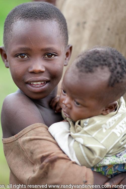 kibuye and nyrasunge Rwanda.Photo Randy Vanderveen.Rwanda.A Rwandan girl with baby