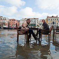 Tourists have fun near Rialto in Central Venice during seasonal High Tide. A few days of exceptional high tides up to 120cm are expected during the next few days meaning 30% of Venice will be under water