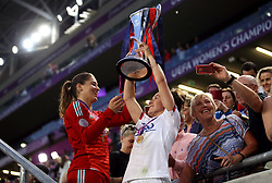 Lyon Women's Lucy Bronze celebrates with the trophy after the match