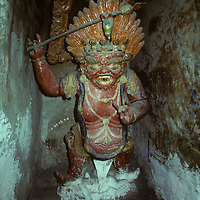 A statue of Bhairava, an angry Tibetan Buddhist manifistation of a Boddhisathva resides in a gompa (temple) in Braga village, north of Annapurna, on Nepal's Around Annapurna trek.