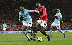 Manchester City's Eliaquim Mangala (left) and Manchester United's Romelu Lukaku battle for the ball during the Premier League match at Old Trafford, Manchester.