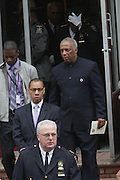 l to r: Deputy Mayor Walcott and Councilman Charles Baron at the funeral for NYPD Officer Omar Edwards held at Our Lady of Victory in Brooklyn on June 4, 2009..NYPD Officer Omar Edwards posthumusly promoted to the rank of Detective was killed by NYPD Detective Andrew Dunton in a case of friendly fire, when Edwards was takened for a suspect with gun in hand. On Thursday June 4 2009, Officer Omar J. Edwards, 25, was shot by a fellow officer on a Harlem street while in street clothes. He had just finished his shift, and had his service weapon out, chasing a man who had broken into his car, police said. Three plainclothes officers on routine patrol arrived at the scene and yelled for the two to stop, police said. One officer, Andrew Dunton, opened fire and hit Edwards three times as he turned toward them with his service weapon. It wasn't until medical workers were on scene that it was determined he was a police officer.