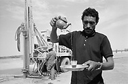 MALI. Tarhara. 10/02/1987: Mr Kadaka, who asked for the drilling, serving thea at the second drill site. The first attempt was fruitless at 60m. The second one was successfull at 45m.