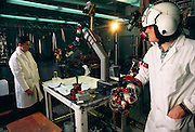 Virtual reality in undersea exploration: bench testing of an undersea tele-robotic robot arm, being developed for the U.S. Navy by the Center for Engineering Design at the University of Utah, Salt Lake City. The functions of this robot are the performance of complex underwater tasks by remote manipulation from the surface. Underwater video cameras & other imaging systems relay information to a computer that produces a 3-D virtual image of the seabed. The operator is linked to this world through a headset equipped with 3-D goggles, & spatial sensor, and data gloves or other clothing that relay precision movements back through the computer to tools on the robot's limbs. (1990)