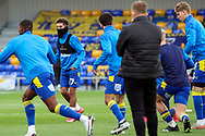 AFC Wimbledon midfielder Ayoub Assal (17) warming up prior to kick off during the EFL Sky Bet League 1 match between AFC Wimbledon and Lincoln City at Plough Lane, London, United Kingdom on 2 January 2021.