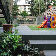 Garden with playground for kids and entertenment area for adults with custom BBQ