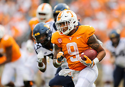 Sep 1, 2018; Charlotte, NC, USA; Tennessee Volunteers running back Tim Jordan (9) runs the ball during the third quarter against the West Virginia Mountaineers at Bank of America Stadium. Mandatory Credit: Ben Queen-USA TODAY Sports
