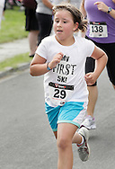 Middletown, New York - A runner races to the finish line in the 15th annual Ruthie Dino Marshall 5K Run and Fun Walk hosted by the Middletown YMCA on Sunday, June 5, 2011.
