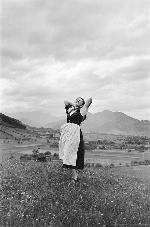 Herta Lindinger with scarf in grassy field, Breitenau, Austria, 1937