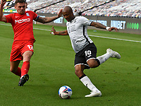 Football - 2020 /2021 EFL Championship - Swansea City vs Birmingham City <br />      <br /> André Ayew of Swansea City on the attack Harlee Dean of Birmingham defends <br /> in a match played without fans at the Liberty Stadium<br /> <br /> COLORSPORT/WINSTON BYNORTH